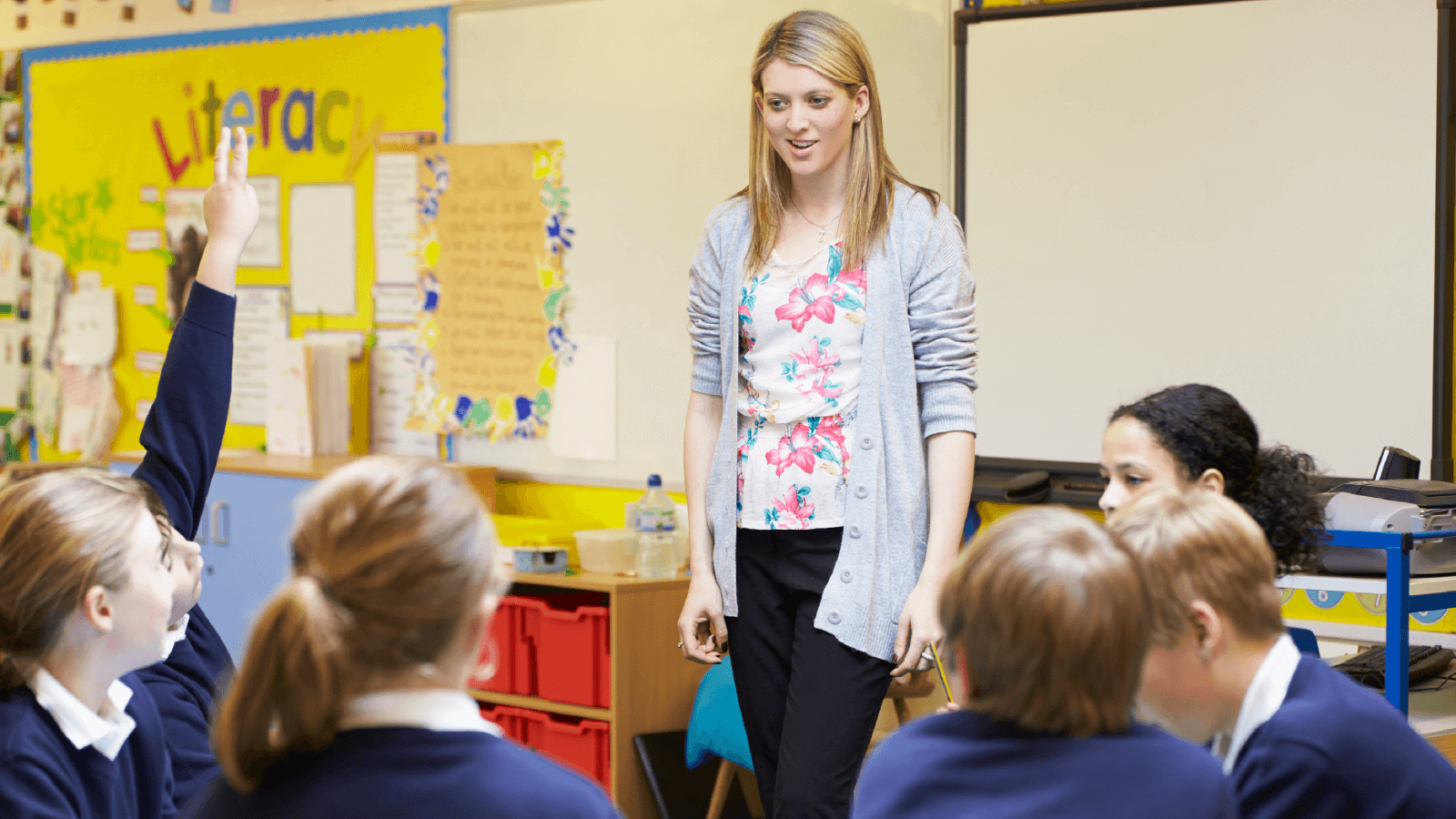 role of an education assistant A teaching assistant interacts with a reading child a teaching assistant or teacher's aide ( ta ) or education assistant ( ea ) is an individual who assists a teacher with instructional responsibilities.